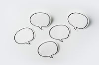 Top view of speak bubble on white background desk for mockup