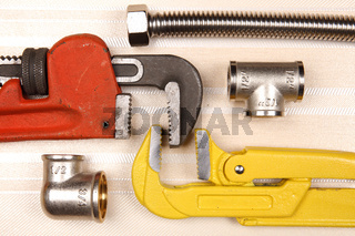 Fitting and two adjustable wrenches for plumbing works