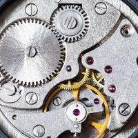 gears of mechanical wristwatch close up