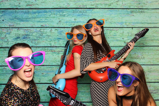 girl tied with plastic guitars - photobooth party