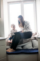Mother and her daughter girl play in kids room