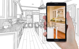 Hand Holding Smart Phone Displaying Photo of Kitchen Drawing Behind.