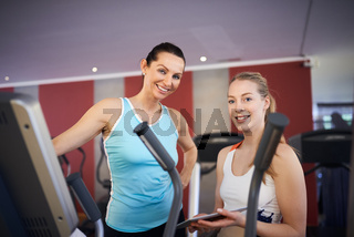 Two happy women in the gym