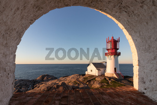 Lindesnes Fyr, historic lighthouse in Norway, seen through a rounded window