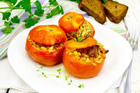 Tomatoes stuffed with bulgur in plate on table