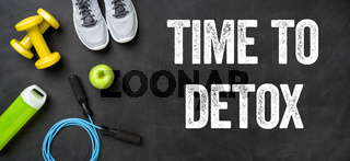 Fitness equipment on a dark background - Time to detox