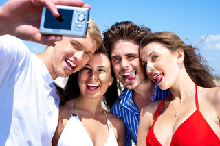 Group of young friends standing together taking a self portrait
