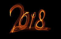 Happy new year 2018 isolated numbers lettering written with fire flame or smoke on black background