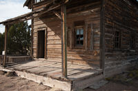 Old Fashioned wooden building with wood covered porch in state of New Mexico.