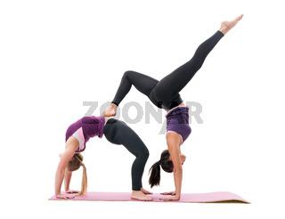 Sporty girls in violet tops and leggings in studio