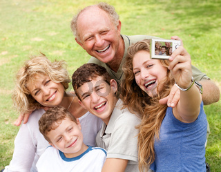 Family outdoors snapping self portrait and enjoying the moment