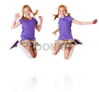 Happy identical twins jumping and laughing