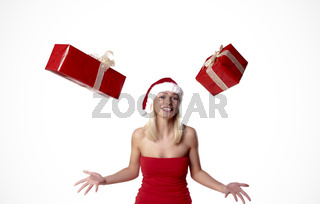 Cheerful Blond Santa Girl Juggling With Presents