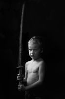 little boy posing with sharp samurai sword