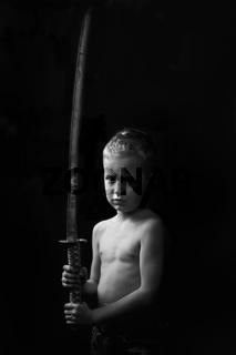 little boy posing with sharp samurai sword