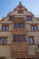 Colmar, Historical tag at Maison des Têtes, Place de l'Ancienne Douane