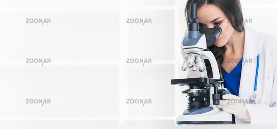 Female scientist with microscope