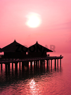 Water bungalows and sunset