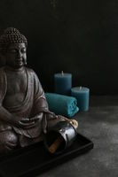 buddah witn candle and towel spa concept