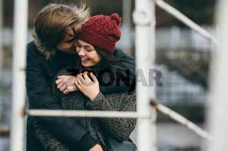 beautiful couple having fun on the pier