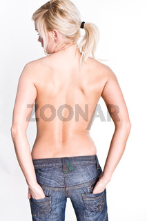 Sexy Female blonde topless wearing jeans From the Back