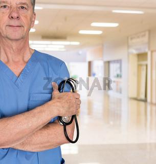 Senior medical consultant in blue scrubs