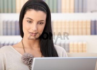 Closeup portrait of woman with laptop