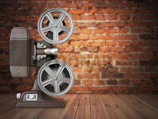 Vintage projector on the bricks background. Cinema, movie or video concept.