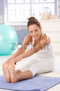 Attractive woman doing exercises on floor