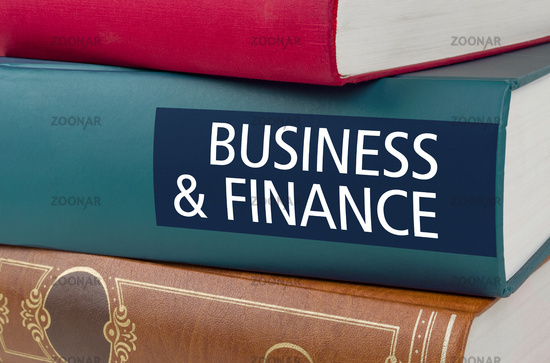 A book with the title Business and Finance written on the spine