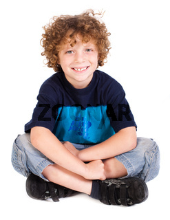 Cheerful kid relaxing on floor
