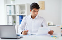 businessman working with papers at office