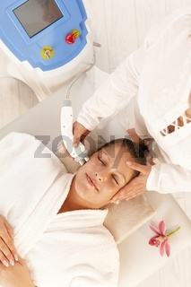 Woman getting radio frequency treatment