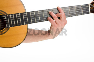 male hand holding a chord on a classsical guitar