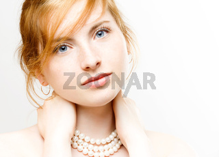 portrait of young beautiful woman with pearl necklace