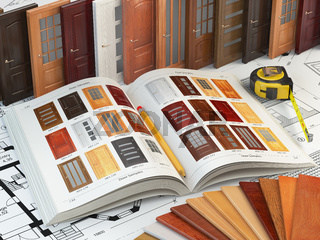 Wooden doors, cataiog with samples of doors and wood samples on the drafts. Interior design and construction concept.