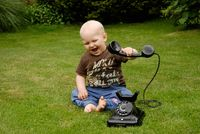 Child with an old phone