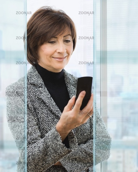 Senior businesswoman using mobile