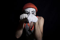 Portrait of fighting mime