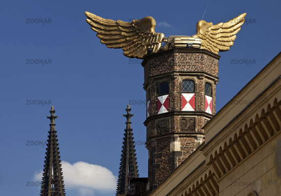 golden car with wings on the roof of municipal museum, Cologne, North Rhine-Westphalia, Germany