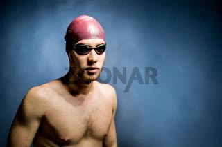 Studio shot of a handsome swimmer
