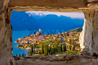 Malcesine and Lago di Garda aerial view through stone window