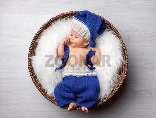 Beautiful newborn inside a wicker basket