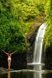 Young woman in bikini standing at Wainibau Waterfall on Taveuni Island, Fiji