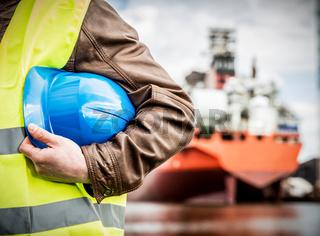 Shipbuilding engineer with safety helmet in shipyard