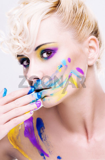 beauty blonde woman dirty messed with the color paint match her makeup