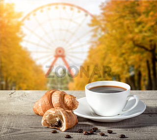 Cup of coffee with croissants