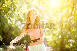 Ginger young girl on bicycle