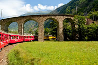 Swiss mountain train Bernina Express crossed through the high montains