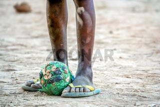 Poor african boy football